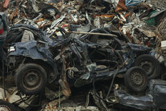 Scrap yard with crushed cars Royalty Free Stock Photo