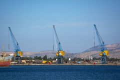 Scrap yard. Heavy duty cranes in a Scrap yard in the mediterranean sea Royalty Free Stock Photography
