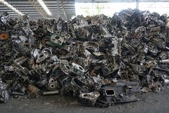 Scrap yard for recycle the engine and automotive parts. Engine junkyard. That old, cracked engine block. Metal recycling yard. Scr. Ap metal recycling yard royalty free stock images