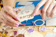 Scrapbook. Background. Hands, Card and tools with decoration Royalty Free Stock Images