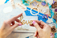 Scrapbook. Background. Hands, Card and tools with decoration Stock Image