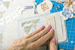 Scrapbook. Background. Hands, Card and tools with decoration Royalty Free Stock Photos