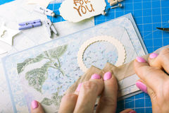 Scrapbook. Background. Hands, Card and tools with decoration Stock Photography