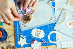 Scrapbook. Background. Hands, Card and tools with decoration Royalty Free Stock Photo