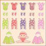 Scrapbook elements with baby clothes Stock Photo