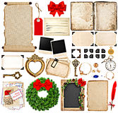 Scrapbook elements for christmas holidays greetings. Old book pages, paper, scroll, wreath, blackboard, corner and photo frames isolated on white background Royalty Free Stock Images