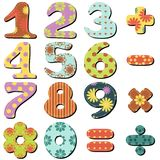 Scrapbook numbers and signs. On white background Royalty Free Stock Image