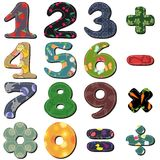 Scrapbook numbers and signs on white background Royalty Free Stock Images