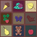 Scrapbook objects on patchwork background Stock Photos
