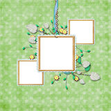 A scrapbook page. With three frames hanging on a chain with the ribbon and light green patterned paper Stock Images