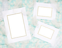Scrapbook page. With frames and fuzzies on a background of blue fabric Stock Photography