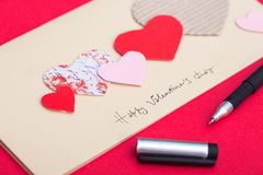 Scrapbook valentines day. Scrapbook background. girl holding a postcard on the valentines day Royalty Free Stock Photos