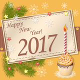 Scrapbooking card Happy New Year 2017. Vector design of new year`s image with scrapbooking card and text Happy New Year 2017 and cupcake with candle.  EPS 10 Stock Photo