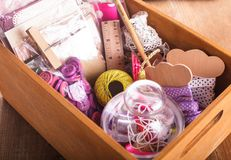 Scrapbooking. Craft materials in a wooden box stock images