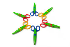 Scrapbooking Craft Scissors. A photo a 6 pair of scrapbooking scissors arranged in a circle and isolated on a white background Royalty Free Stock Photography