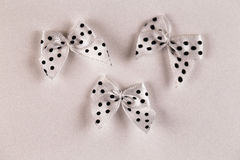 Scrapbooking elements Small bows on the wood backgraund. Stock Image