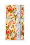 Scrapbooking holder for travel documents. Beautiful handmade scrapbooking holder for travel documents with ribbon closure. Floral fabric design. isolated on Stock Photos