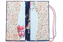 Scrapbooking holder for travel documents. Beautiful handmade scrapbooking holder for travel documents with ribbon closure. Floral fabric design. isolated on Stock Images