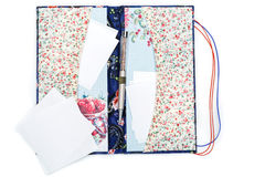 Scrapbooking holder for travel documents. Beautiful handmade scrapbooking holder for travel documents with ribbon closure. Floral fabric design. isolated on Royalty Free Stock Image