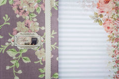 Scrapbooking holder for travel documents on floral paper. Beautiful handmade scrapbooking holder for travel documents with lace detail and ribbon closure lying Stock Image