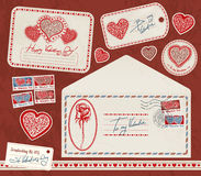 Scrapbooking kit. Valentine's day red scrapbooking kit with hearts, cards, envelope, sticker, postage stamps Royalty Free Stock Photo