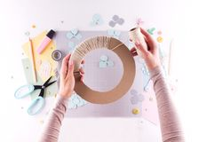 Scrapbooking master class. Diy. Make a spring decor for interior - floral wreath made of paper. Pastel colors. Women`s hobby. stock image