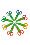 Scrapbooking Scissors. A photo a 8 pair of scrapbooking scissors arranged in a circle and isolated on a white background Royalty Free Stock Images