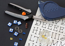 Scrapbooking supplies. Including glue dots, alphabets, embellishments, scissors, stickers, and cardstock Stock Photos