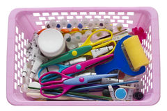 Scrapbooking tools in pink plastic basket Royalty Free Stock Photos