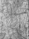 Scraped Grooves in Metal. A B&W image of rough textured metal covered in scraped grooves and scratches Royalty Free Stock Photography