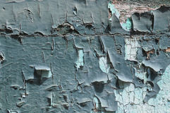 Scraped paint. On an ancient door. Suitable as background stock photo