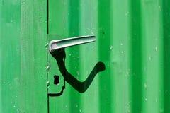 Scraped painted door and door handle Royalty Free Stock Photo