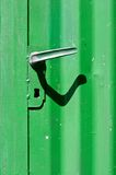 Scraped painted door and door handle Stock Photography