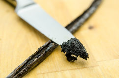 Scraped Vanilla Beans and Knife Royalty Free Stock Photos