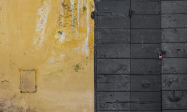 Scraped wall and a wooden door Royalty Free Stock Photography