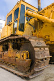 Scraper. Old and heavy bulldozer scraper, particular of track Royalty Free Stock Image