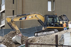 Scraper bulldozer. Construction site. Houses. Royalty Free Stock Photos