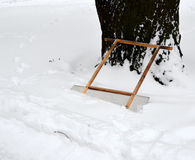 Scraper for remove snow in snowdrift near cleared-away path 1 Royalty Free Stock Photos