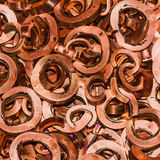 Scrapheap of copper. Close up of scrapheap of copper from hole punching and shearing process, waiting for recycling, square cropped Stock Photo