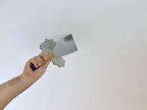 Scraping a Ceiling with a Spatula Stock Photo