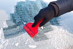 Scraping ice from the car Stock Photos