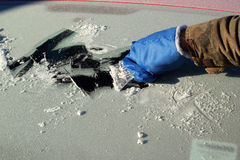 Scraping ice from car window Royalty Free Stock Photos
