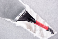 Scraping ice from the car window Royalty Free Stock Photography
