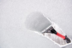Scraping ice from the car window Royalty Free Stock Images