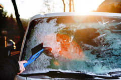 Scraping ice from the car window Royalty Free Stock Photo