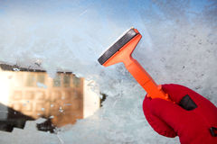 Scraping ice from the car window Stock Photos