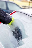 Scraping ice from car window stock images
