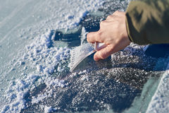 Scraping Ice Off the Windshield Royalty Free Stock Image