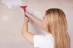 Scraping off old wallpaper Royalty Free Stock Image