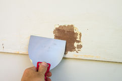 Scraping Old Paint Royalty Free Stock Image